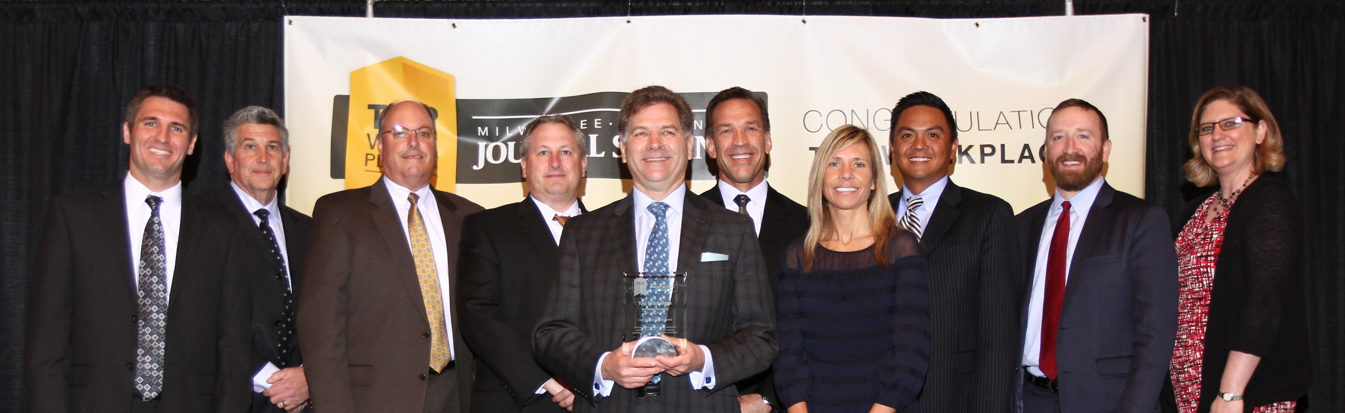 Ten employees from Commerce State Bank accepts award for Milwaukee Journal Sentinel Top Workplace.